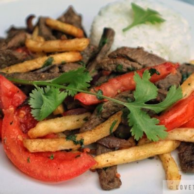 lomo saltado, peruvian, beef, stir-fry, cilantro, french fries, tomatoes, aji amarillo, rice, fluffy, serve, with