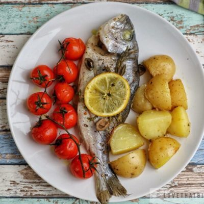 dorado, sea bream, baked, potatoes, tomatoes, cherry, lemon, sliced, classic, baked, recipe, easy, fresh, fish, herbs, rosemary, olives, black, thyme tasty, delicious
