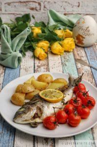 dorado, sea bream, baked, potatoes, tomatoes, herbs, spiced, tasty, easy, recipe, easter, classic, dish, meal, menu, roses, yellow, napkin, rabbit, fold